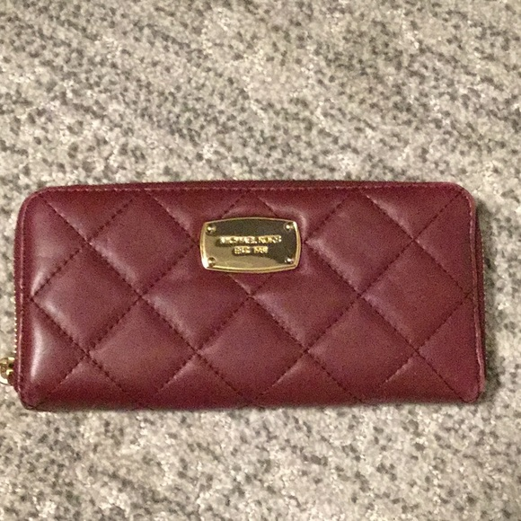 Michael Kors Handbags - Michael Kors burgundy quilted leather wallet